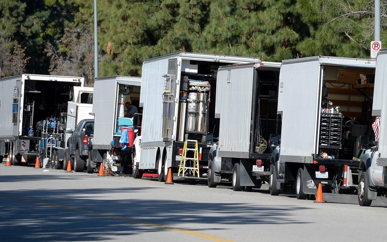 line of parked film trucks